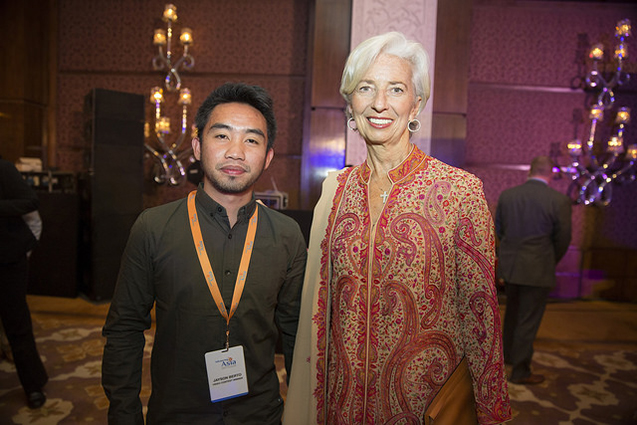 PhilRice videographer Jayson C. Berto poses with International Monetary Fund Managing Director Christine Lagarde during the awarding ceremony at the Taj Palace Hotel in New Delhi, India, 11 March. IMF Staff Photo/Stephen Jaffe