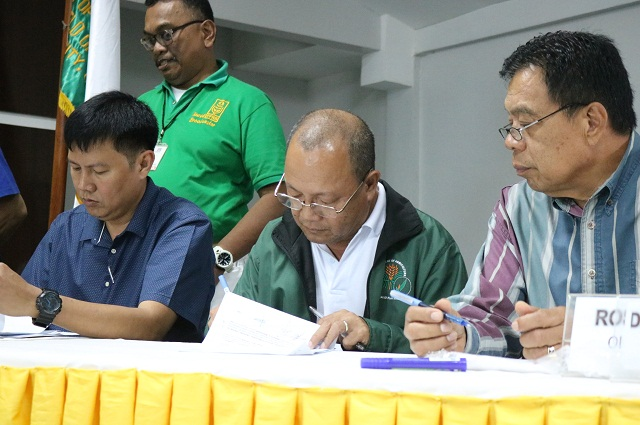 PhilRice Isabela Director, Leo C. Javier, together with the station's partners, signing the Memorandum of Agreement during the launching of the SOA program on climate smart agriculture in Cagayan Valley