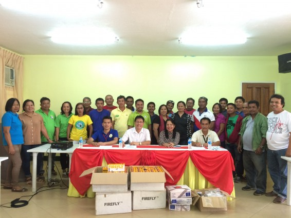 Worry-free smiles. (seated L-R) Mr. Julius Quijada, representative from the Office of Provincial Agriculturist of Agusan del Sur; Dr Caesar Joventino M. Tado, acting branch director of PhilRice Agusan; Hon. Leonida P. Manpatilan, mayor of Esperanza; and Mr. Jose Zaldy S. Manug, municipal agriculturist of Esperanza; together with their barangay captains.